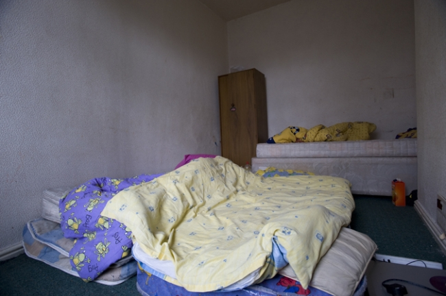 A family of eleven share a two bedroomed house. This bedroom is shared by four teenage boys.
