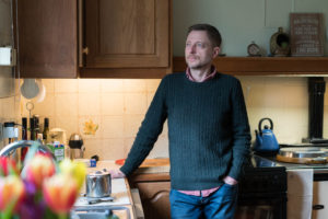 John Hatch, 48, at home where he cared for his mother